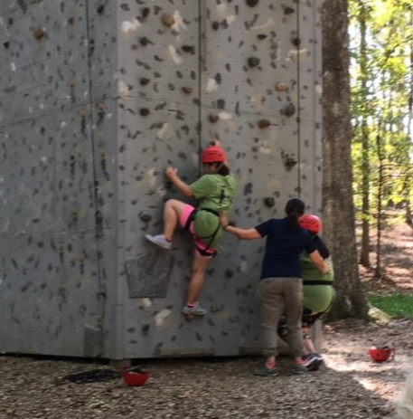 FSPS migrant students climb a rock wall at the Arkansas Migrant Education Student Leadership Academy (AMESLA).