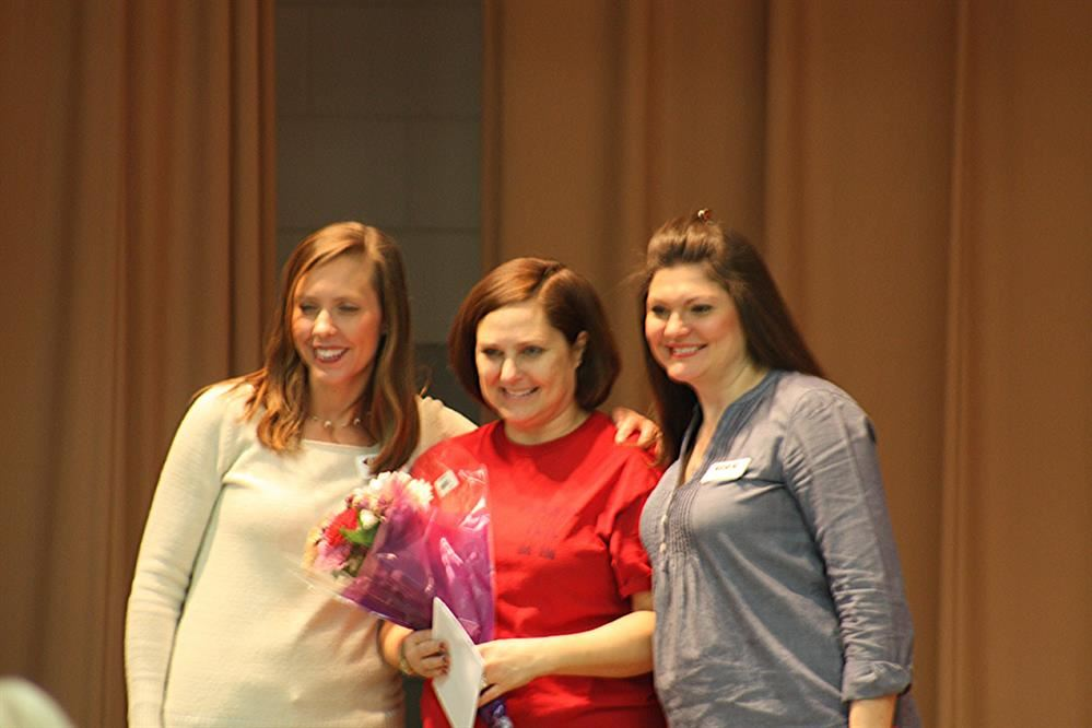 Teacher Laura York receiving award