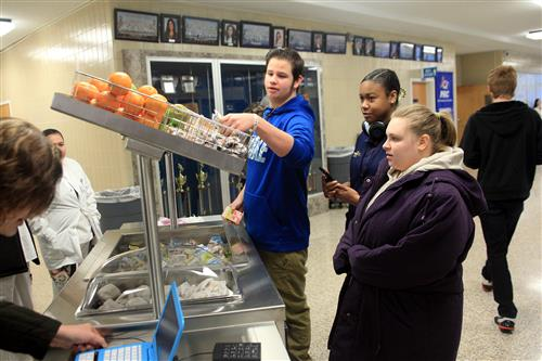 Students choose items off of Southside High School breakfast cart